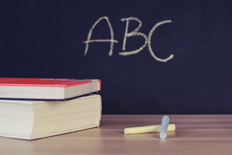 books-chalk-and-blackboard-in-classroom