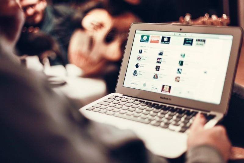 man-using-laptop-in-cafe