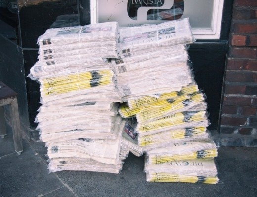pile-of-newspapers-in-foil-on-street